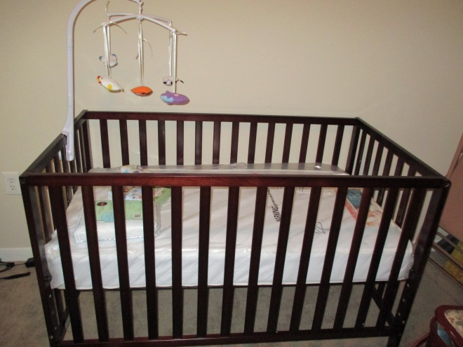 We got a crib! And I only maimed myself twice putting it together. The mobile was a gift from my family.