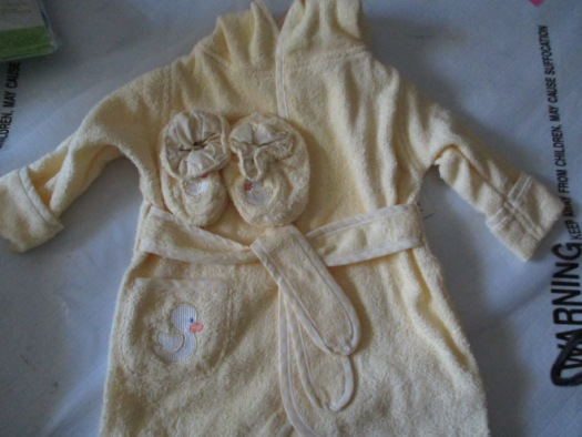 """I found this baby bathrobe at Ross and thought, """"My child needs this."""" Adorable/embarrassing pictures to come after New Friend is born."""