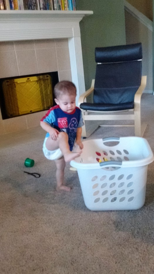 Climbing into the laundry basket is helping, right?